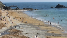 Kilfarassey beach in summer with lots of people