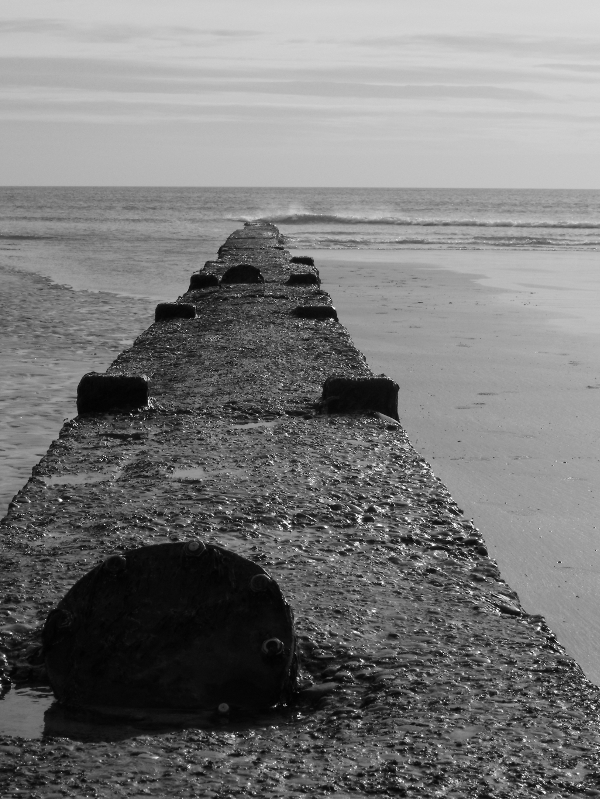 Old pipe on Tramore Beach, Co. Waterford, Ireland