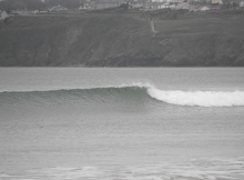 One wave seems to appear out of a flat surrounding sea at Tramore. easy to see on a beach, not easy to see elsewhere.