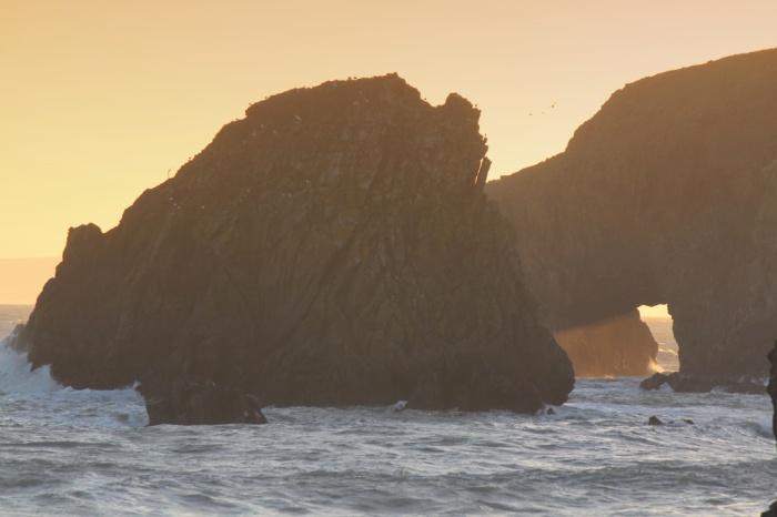 Golden light through a Copper Coast arch