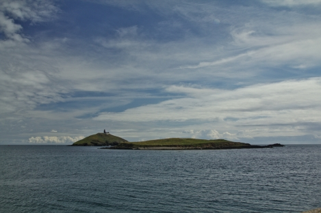 Ballycotton Island and lighthouse beyond the nearby low island.