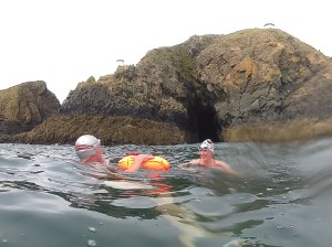 ILDSA Swimmer Paul McCambridge using a standard Tow Float on a visit to The Cave of the Loneswimmer with Mo MCoy