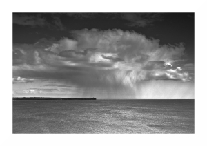 Black and white photo of a sudden squall storm in Tramore Bay in Ireland