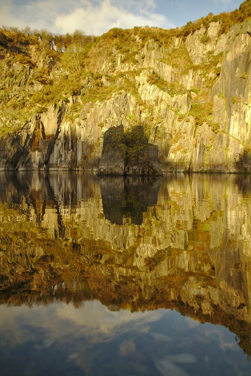 Golden evening light makes a dangerous water filled slate quarry seem magical