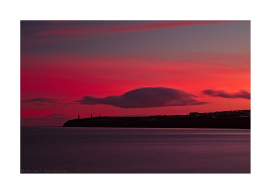 Tramore Bay and the Metalman after sunset