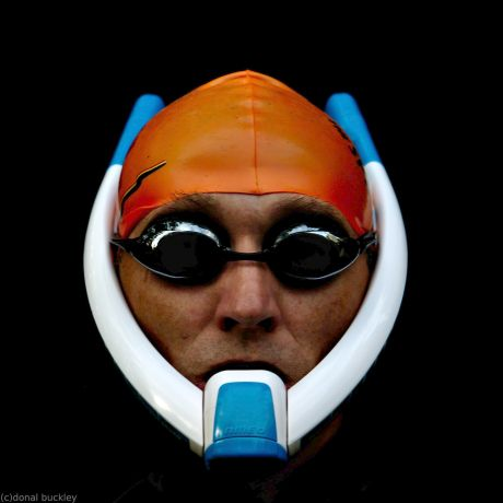 Loneswimmer wearing an Ameo Powerbreather snorkely