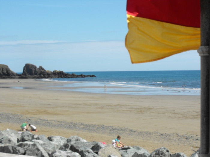 Bunmahon at low tide and lifeguard flag