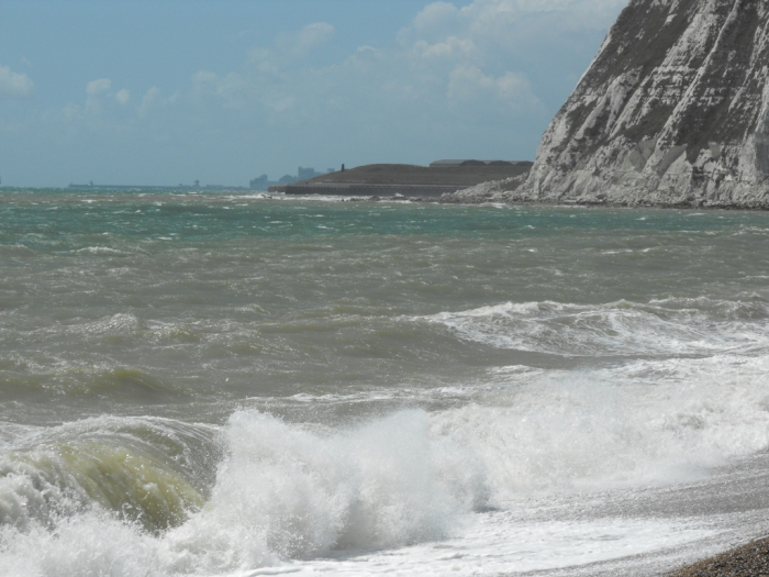 Onshore waves break onto Dover's steep shingle Shapkespeare Beach, the traditional starting point of English Channel solos