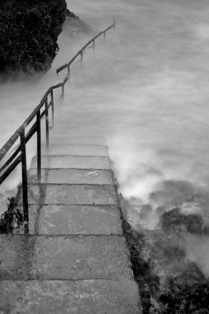Long exposure black & white image othe steps at Guillamene Cove in March