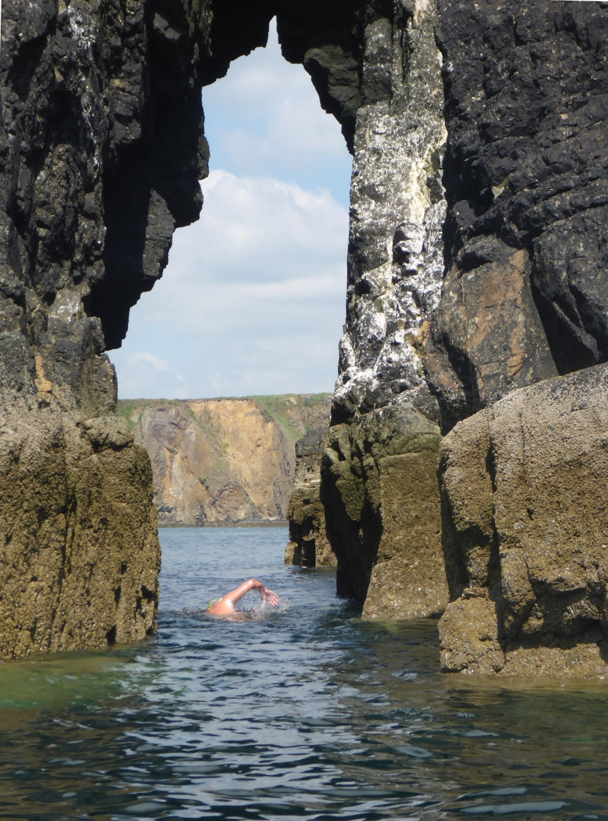 Swiming through an offshore sea arch