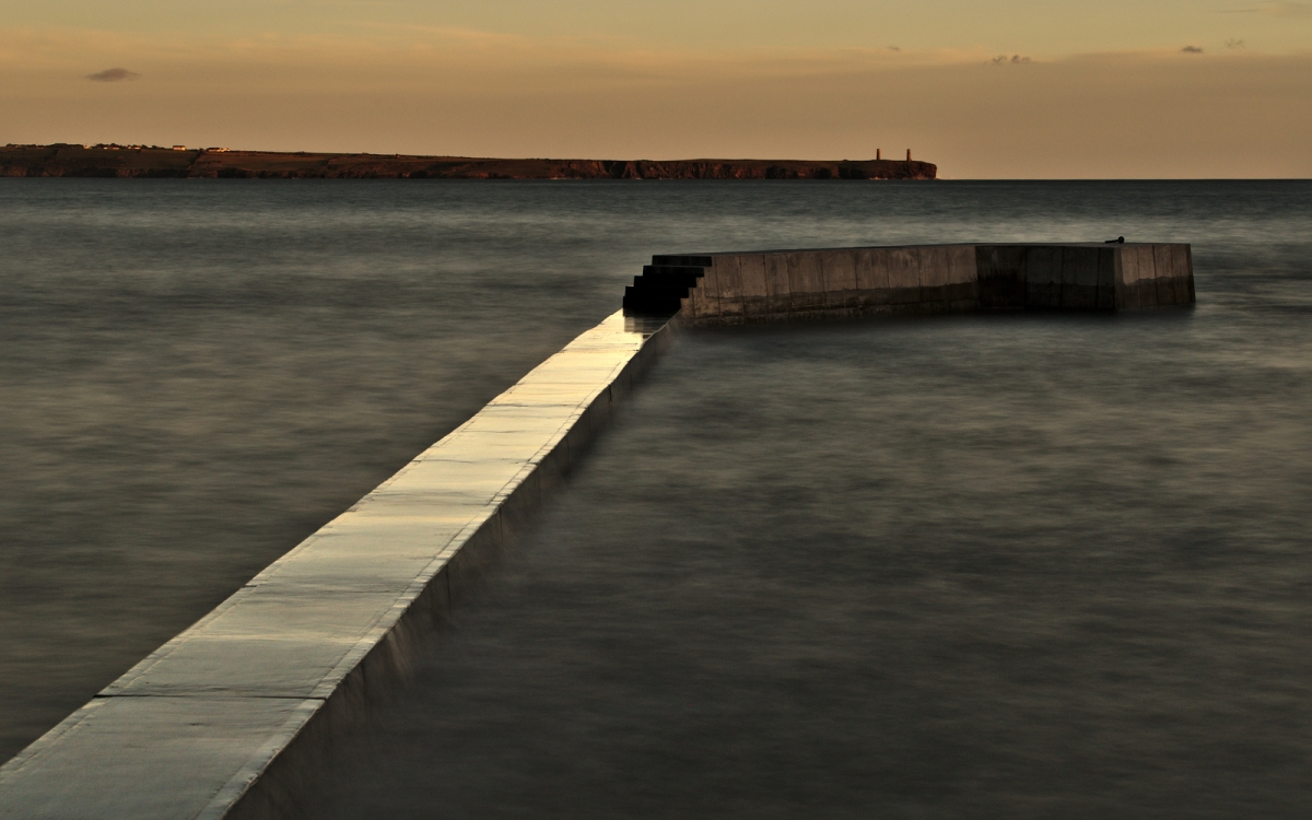 Long exposure of pier wall at sunset